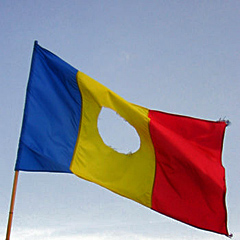 https://static.tvtropes.org/pmwiki/pub/images/350px_RomanianFlag_withHole.jpg