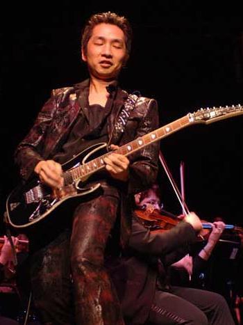 https://static.tvtropes.org/pmwiki/pub/images/Akira_Yamaoka_Rocking_Live_2338.JPG