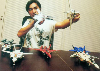 https://static.tvtropes.org/pmwiki/pub/images/Shoji_Kawamori_with_his_work_8058.PNG