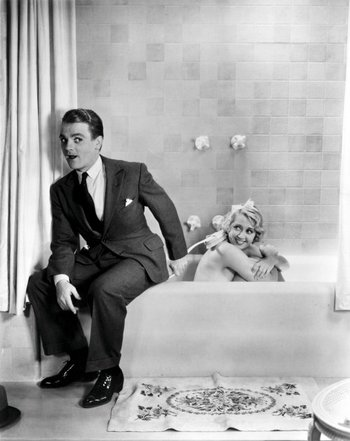 https://static.tvtropes.org/pmwiki/pub/images/blonde_crazy_1931_001_cagney_in_suit_by_blondell_in_bath_00m_zhg.jpg
