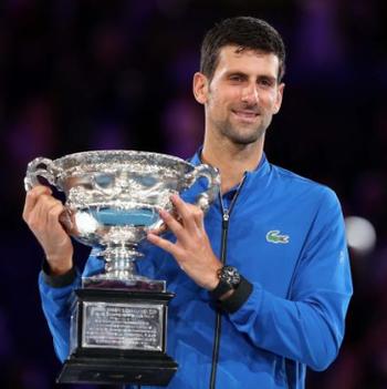 https://static.tvtropes.org/pmwiki/pub/images/djokovic_holding_the_2019_australian_open_trophy.png
