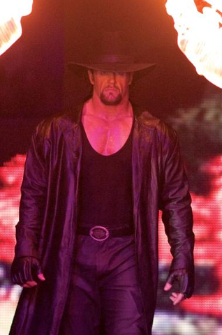 http://static.tvtropes.org/pmwiki/pub/images/gallery_showbiz_wrestlemania_the_undertaker.jpg