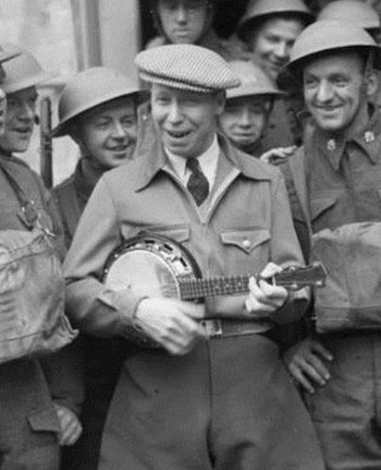 https://static.tvtropes.org/pmwiki/pub/images/george_formby_with_the_army_in_france_1940_cropped_35.jpg