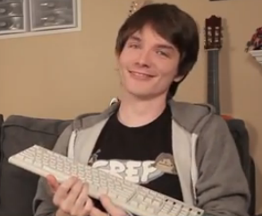 https://static.tvtropes.org/pmwiki/pub/images/grep_shirt_ross_with_keyboard_7080.png