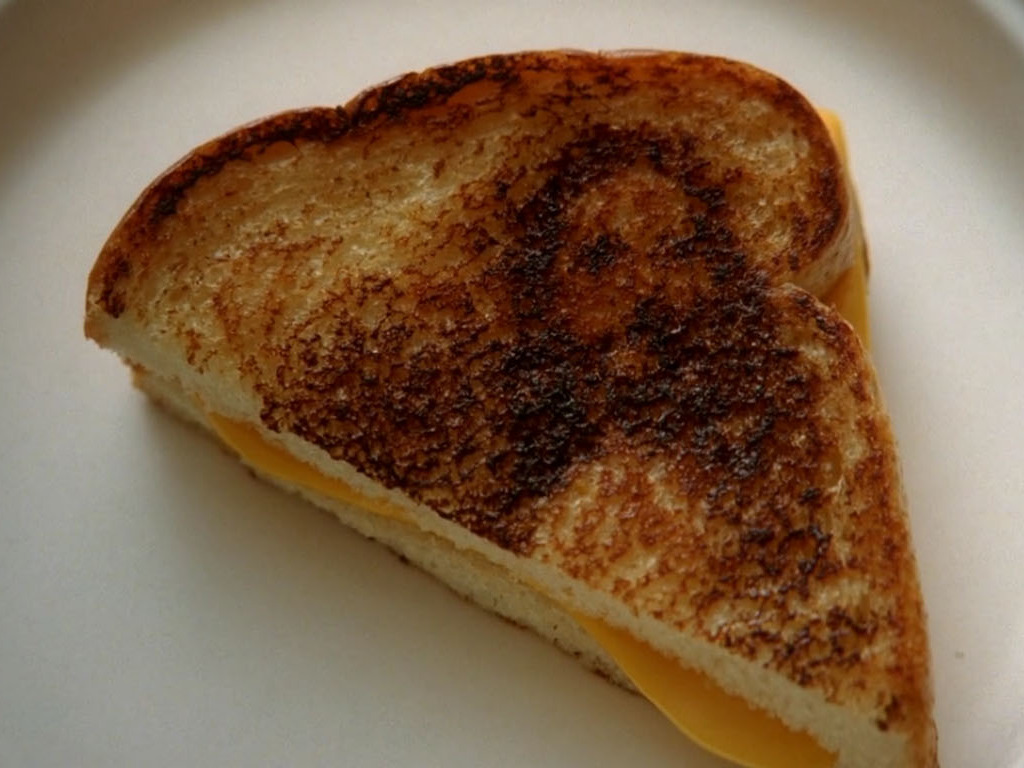 https://static.tvtropes.org/pmwiki/pub/images/grilled_cheesus.jpg