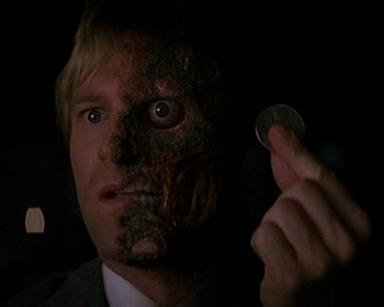 http://static.tvtropes.org/pmwiki/pub/images/harvey_dent_becomes_the_villain_by_the_end_of_the_film.jpg