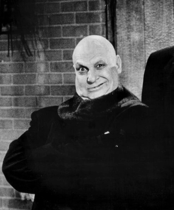 https://static.tvtropes.org/pmwiki/pub/images/jackie_coogan_as_uncle_fester_the_addams_family_1966.jpg