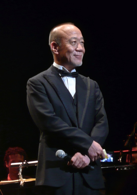 https://static.tvtropes.org/pmwiki/pub/images/joe_hisaishi_2011.jpg