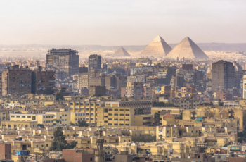 https://static.tvtropes.org/pmwiki/pub/images/landscape_of_cairo_egypt_pyramids_on_the_background_drowning_in_waste_woima_corporation.png