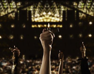 https://static.tvtropes.org/pmwiki/pub/images/lighter_at_concert.jpg