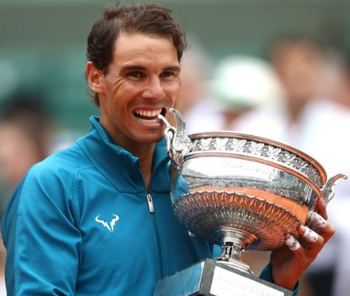 https://static.tvtropes.org/pmwiki/pub/images/nadal_biting_the_2018_french_open_trophy.png