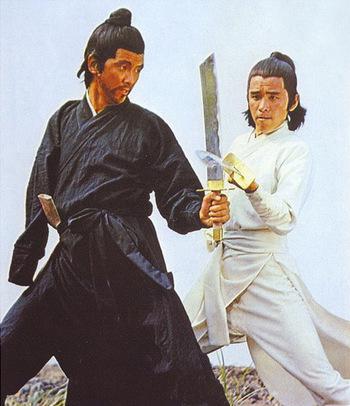 https://static.tvtropes.org/pmwiki/pub/images/onearmed_swordsmen.jpg