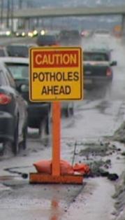 http://static.tvtropes.org/pmwiki/pub/images/potholesahead_331.jpg