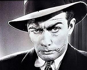 https://static.tvtropes.org/pmwiki/pub/images/screenshot_of_actor_robert_taylors_disfigured_character_in_buried_loot_1935.jpg