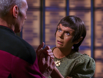 https://static.tvtropes.org/pmwiki/pub/images/tng_who_watches_the_watchers_nuria_is_brought_aboard_the_enterprise.jpg