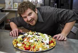 http://static.tvtropes.org/pmwiki/pub/images/tom_pizzica_got_his_own_show_called_outrageous_food_where_he_dares_people_to_eat_a_whole_buncha_crap_3613.jpg